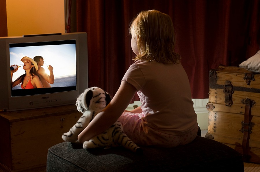 young girl in front of television BIG